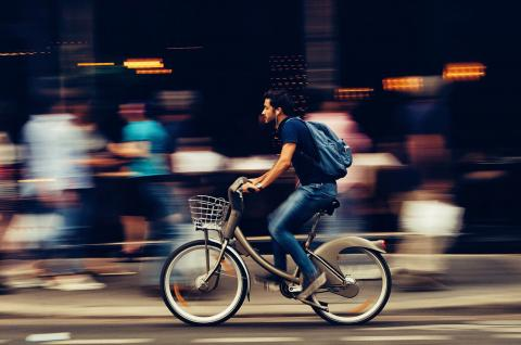 Photo of man riding bicycle.