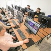 A group of adults participating in a computer class.
