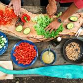 A view from above of a table with an array of chopped vegetables and other colorful ingredients.